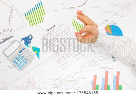 Businessman At The Table With Diferent Financial Data Showing Sign - Ok