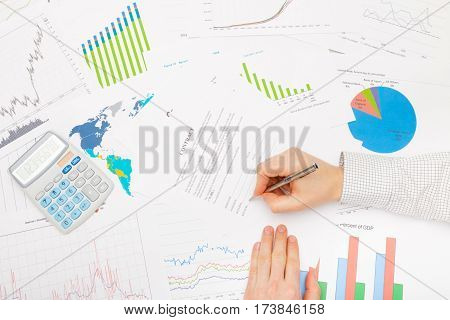Businessman At The Table With Diferent Financial Data - Signing Contract