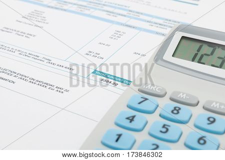 Unpaid Utility Bill And Calculator Next To It