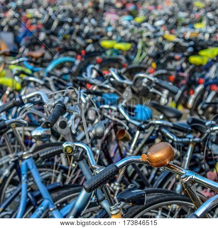 Detail Of Hundreds Of Bicycles In A Town In The Netherlands With A Bell In The Foreground