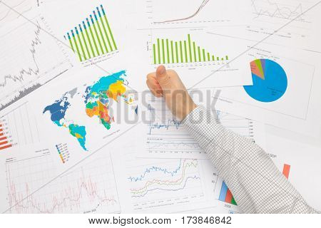 Business Man At The Table With Diferent Financial Data Holding Thumb Up