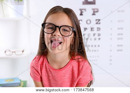 Small girl visiting ophthalmologist