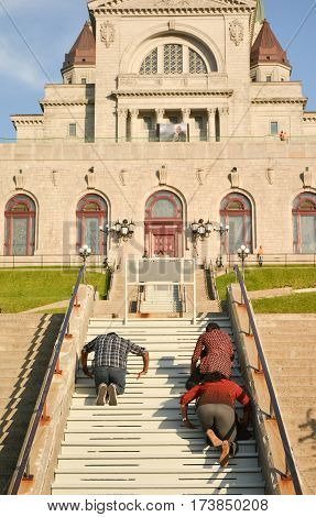 MONTREAL, CANADA - AUGUST 20, 2014: People are praying on steps of Saint Joseph's Oratory of Mount Royal in Canada.
