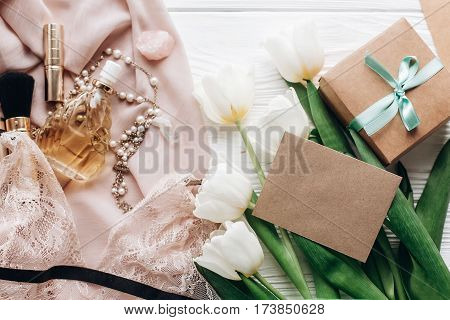 Woman Lace Lingerie Jewelry And Perfume Present On Soft Fabric And Tulips With Empty Greeting Card O