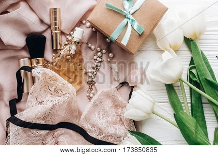 Stylish Craft Present Box And Lace Lingerie Jewelry And Perfume Present On Soft Fabric And Tulips On