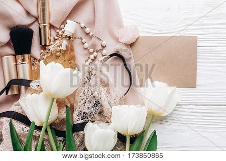 Stylish Woman Set. Lace Lingerie Jewelry And Perfume And Greeting Card On Soft Fabric And Tulips On