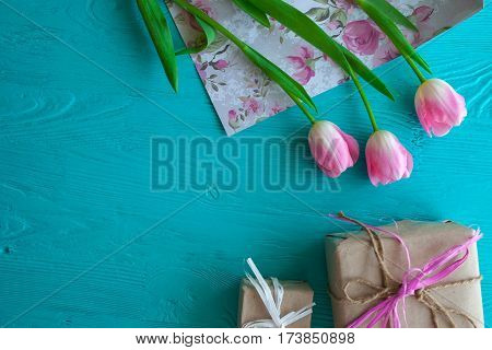 Mother's Day, woman's day. tulips ,presents on wooden background