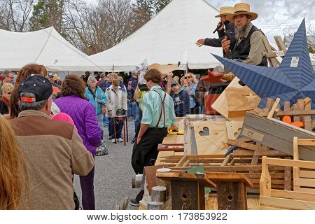 STRASBURG PENNSYLVANIA - February 25 2017: Amish auctioneers volunteer at the annual Mud Sale to benefit the Fire Company. Sale items include quilts antiques crafts food sporting goods tools farm equipment and horses.