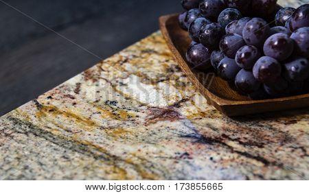 stone surface part of modern kitchen worktop made of granite natural stone, kitchen surface