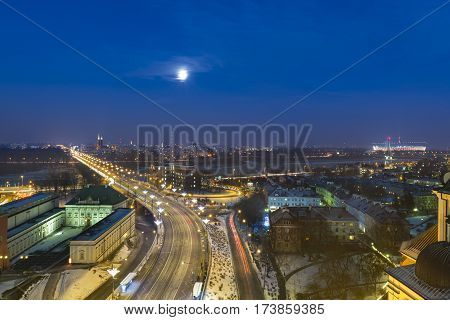 Full Moon over the Vistula River and Mariensztad a historic part of Warsaw's Old Town.
