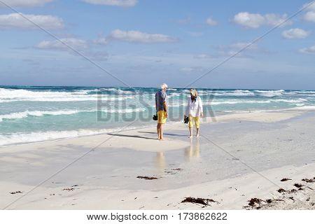 VARADERO,CUBA - JANUARY 1, 2000 People walking on the white sand of a beach in Varadero, Cuba.