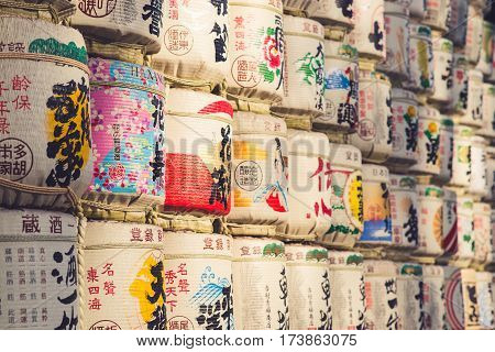 TOKYO JAPAN - MARCH 30: A collection of Japanese sake barrels stacked is at the Japanese Meiji Shrine.