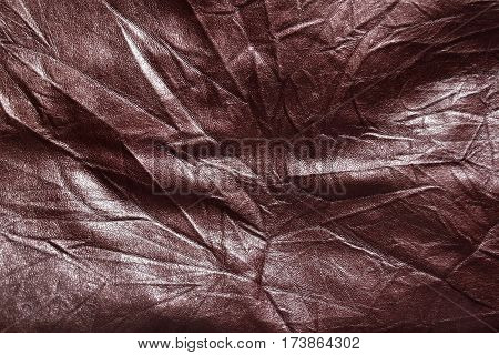 Surface of brown leatherette texture for background.