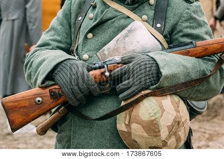 The uniform and outfit of a German soldier with a rifle during the Great Patriotic War. Reconstruction