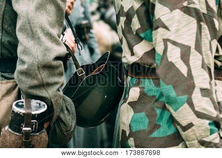 Helmet sloldata German World War II attached to the uniform