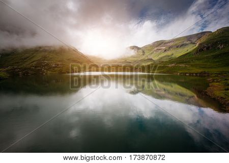 Great view of the mystic lake. Popular tourist attraction. Picturesque and gorgeous scene. Location place Bachalpsee in Swiss alps, Grindelwald valley, Bernese Oberland, Europe. Beauty world.