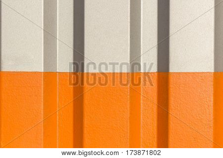 The two halves grey and orange of the figure of corrugated texture.