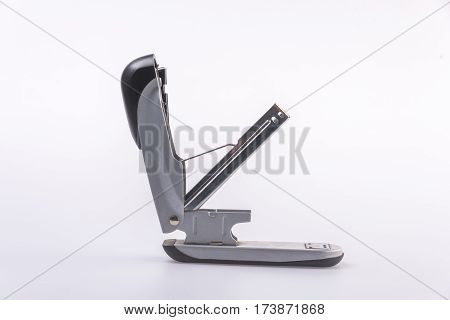 Close-Up Of Stapler On Tableagainst white background.