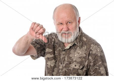 Handsome bald and bearded senior man shows thumbs down gesture, isolated on white background