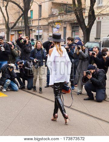 MILAN ITALY - FEBRUARY 23: Fashionable woman poses outside Fendi fashion show during Milan Women's Fashion Week on FEBRUARY 23 2017 in Milan.