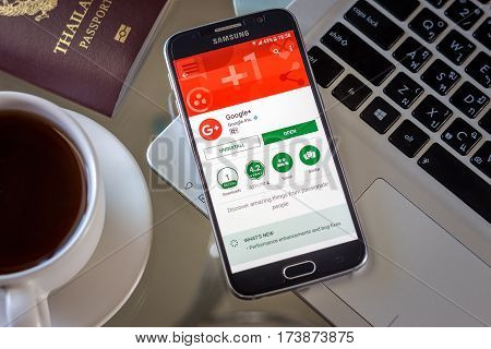 Chiang Mai,Thailand - March 1, 2017: Smartphone Samsung Galaxy S6 open apps google plus application on the screen on the desk.