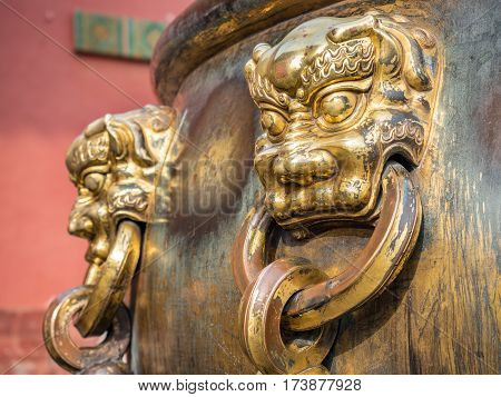 Beijing, China - Oct 30, 2016: Cloesup of ornate bronze handle on water urn at the Hall of Supreme Harmony (Taihedian). Forbidden City (Gu Gong, Palace Museum).