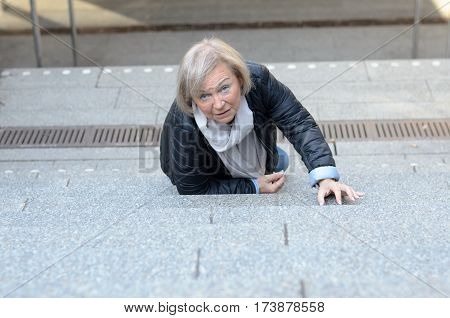 Helpless Senior Woman Falling Down Steps