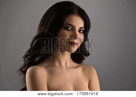 Gorgeous bare shouldered longhaired brunette studio portrait