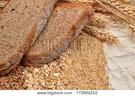 Two Slices Of Bread With Fresh Ears Wheat, Dry Beans Of Wheat, Flour, Integral Wheat Flour And Wheat