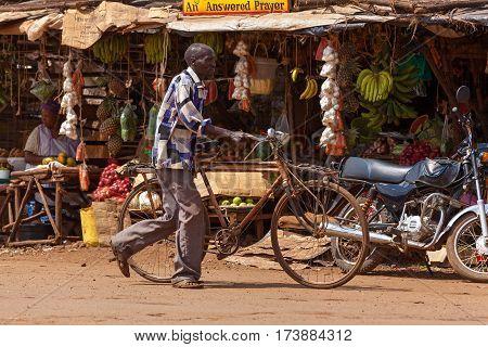 Nairobi Kenya - 07 Januar 2013 a man rolls a bicycle down streetpeople in Kenya