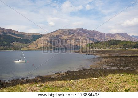 Sailing boat on Loch Leven Scottish lake Scotland Scottish Highlands with mountains