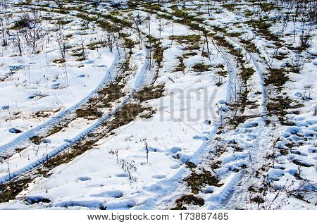 Winter road texture, tire tracks in snow