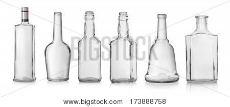Collage of empty bottles of vodka and whiskey isolated on white