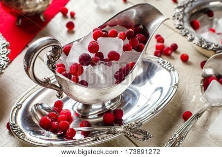Red Berries And Ice In A Beautiful Silver Bowl.