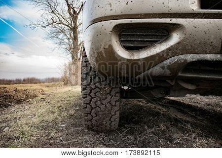 Closeup photo of car wheel on muddy terrain