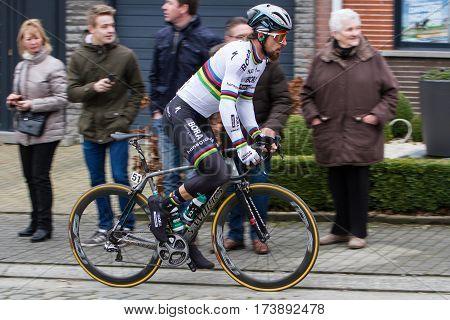 KUURNE BELGIUM - FEBRUARY 26: Peter Sagan (SVK) of team Bora-Hansgrohe races to victory in his world champion kit at Kuurne-Brussel- Kuurne Belgium on February 26 2017
