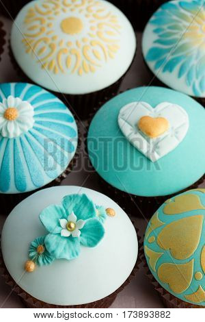 Wedding cupcakes in gold and teal