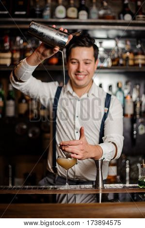 bartender is making a coctail with smile