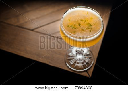 the orange coctail on the brown table