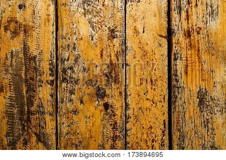 Background of weathered cracked varnished wooden boards. Wood texture
