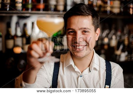smiling close up barman with the coctail