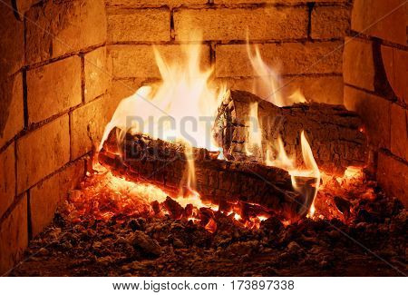 Burning fire wood in a fireplace red
