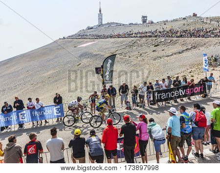 Mont Ventoux France- July 14 2013: The French cyclist Christophe Riblon (Ag2r-La Mondiale Team) and and the Irish cyclist Nicolas Roche (Team Saxo-Tinkoff Team) climbing the last kilometer of the ascension to Mont Ventoux during the stage 15 of the 100 ed