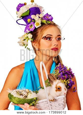 Bunny for easter. Girl holding bunny and eggs. Woman with holiday hairstyle and make up holding rabbit in basket with flowers. Adults at festival. White background.