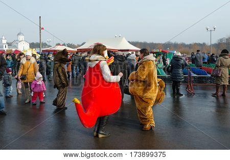 GOMEL BELARUS - FEBRUARY 21 2015: Growth dolls at Shrovetide festivities. Unidentified people visit festive event in Pancake Day