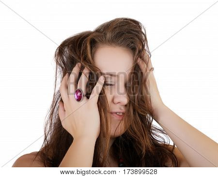 girl with eyes closed hands grasping his head