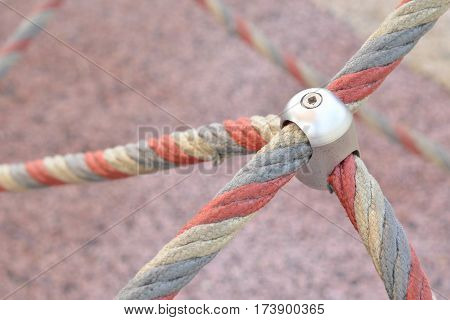Iron jointed point of ropes in children spider web, outdoor equipment.
