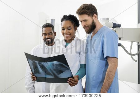 Radiologists Examining Chest X-ray In Examination Room