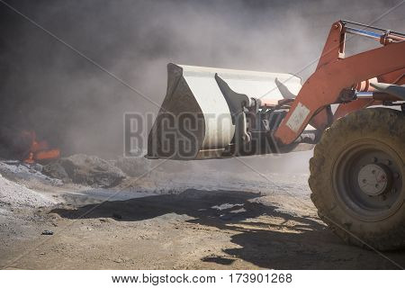 Bulldozer at work in a landfill garabge site