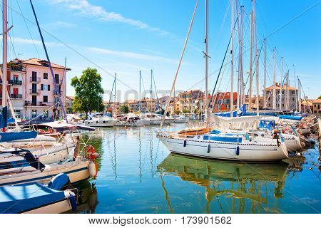 Beautiful Scene Of Boats Lying In The Harbor Of Grado, Friuli-venezia Giulia, Italy At Adriatic Sea